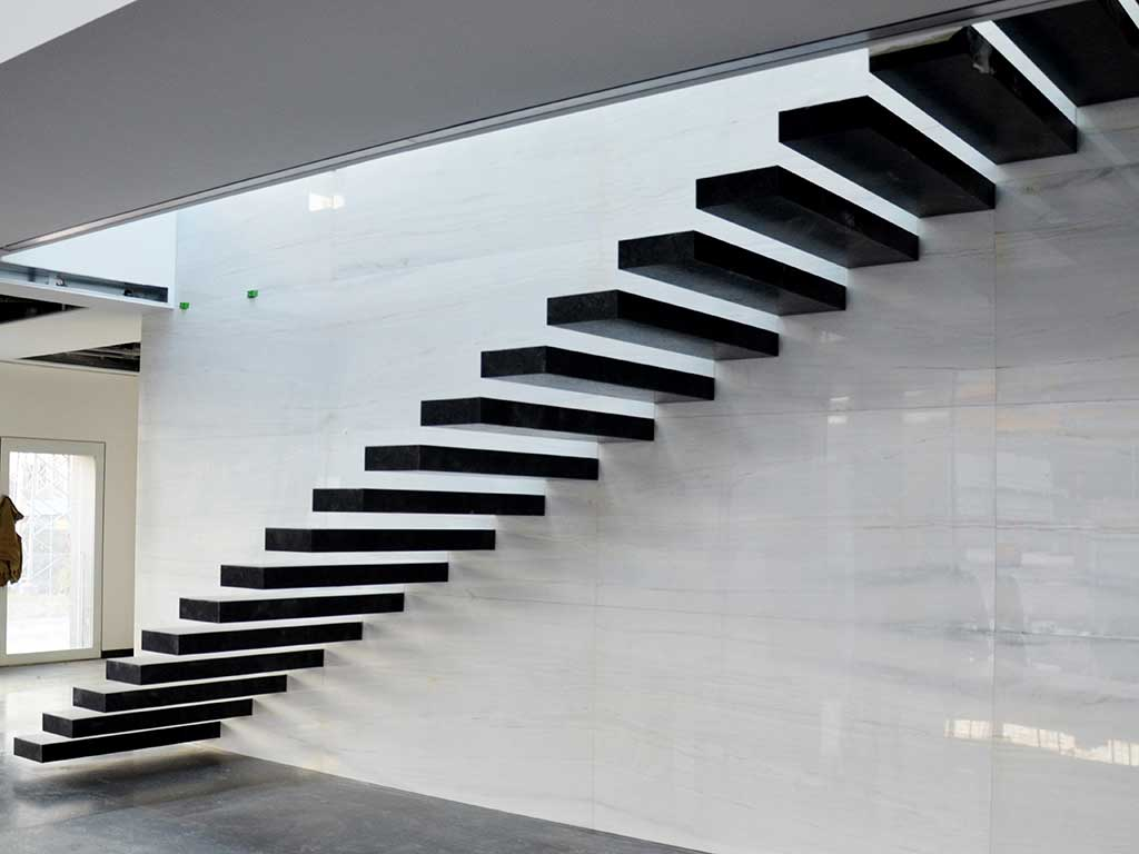 Staircase of Volga Blue with side wall of Bianco Lhasa